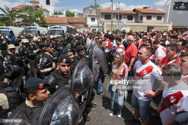 TOPSHOT Picture released by DP via Noticias Argentinas showing police forces blocking supporters of River Plate in the surroundings of the Monumental...