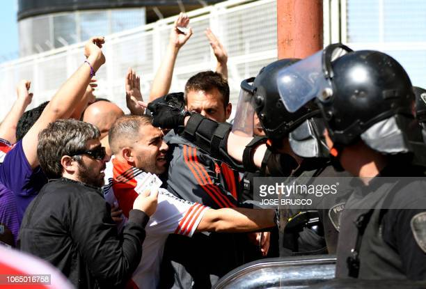 Picture released by DP via Noticias Argentinas showing supporters of River Plate arguing with police forces outside the Monumental stadium in Buenos...