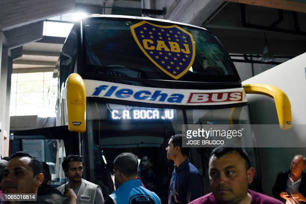 Picture released by DP via Noticias Argentinas showing the bus of Boca Juniors inside the Monumental stadium in Buenos Aires after it was attacked by...