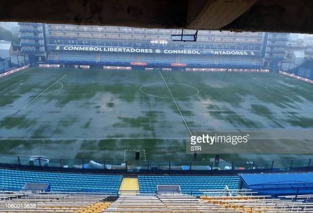 Picture released by Noticias Argentinas showing a general view of the field of La Bombonera stadium in Buenos Aires on November 10 before torrential...