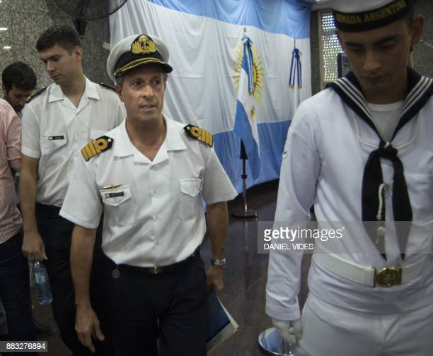 Picture released by Noticias Argentinas showing Argentine Navy spokesman Captain Enrique Balbi leaving after a press conference during which he...