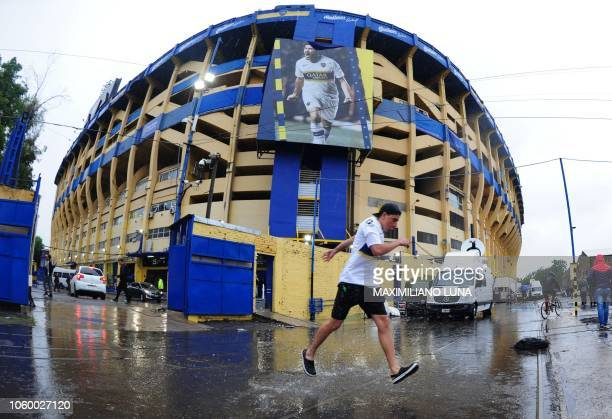 Picture released by Telam showing an outside view of La Bombonera stadium in Buenos Aires on November 10 after torrential rain forced the...