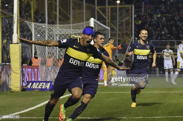 Picture released by Telam showing Boca Juniors' forward Ricardo Centurion celebrating next to teammates forward Cristian Pavon and forward Dario...