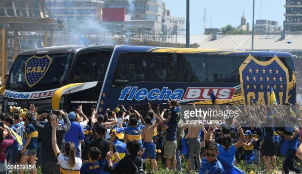 TOPSHOT Picture released by Telam showing fans greeting Boca Juniors players as their bus leaves their hotel on the way to the Monumental stadium in...