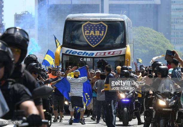TOPSHOT Picture released by Telam showing the Boca Juniors team bus leaving their hotel on the way to the Monumental stadium in Buenos Aires on...