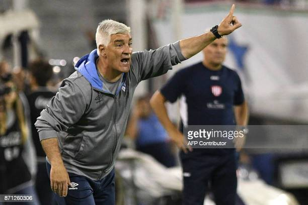 Picture released by Telam showing the coach of Argentine team Velez Sarsfield Omar De Felippe giving instructions during an Argentine Superliga first...