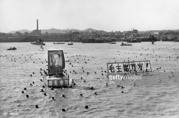 Picture released by the Chinese official news agency shows some 5,000 Chinese following Chairman Mao Zedong's example swimming 02 September 1967, in...