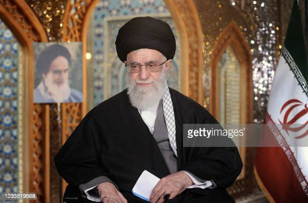 Picture released by the office of Iran's supreme leader Ayatollah Ali Khamenei on March 20, 2013 shows him seated in front of a portrait of his...