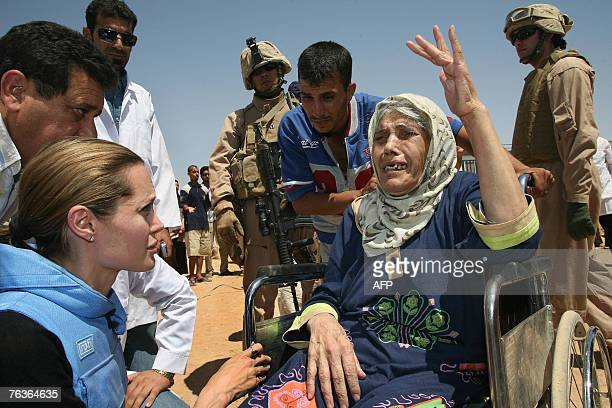 Picture released by the UNHCR showing UNHCR Goodwill Ambassador US actress Angelina Jolie meeting an elderly refugee in a wheelchair one some 1300...