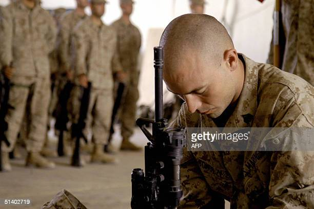 A picture released by the US Marines 05 October 2004 shows Sergeant Ryan Schulze Company F 2nd Battalion 5th Marine Regiment 1st Marine Division...