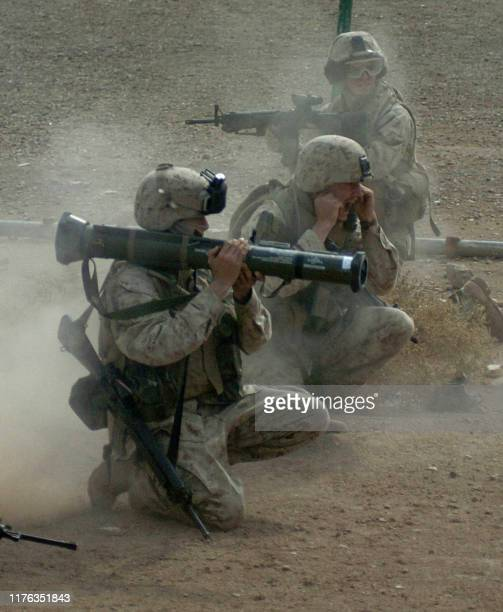 A picture released by the US Marines 25 November 2004 shows a marine with 3rd platoon Charlie Co 1/3 firing an AT4 into a building after taking fire...