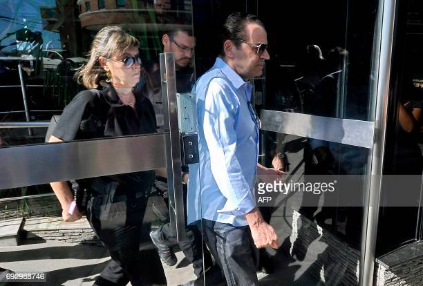 Picture released by Tribuna do Norte showing former Brazil's Tourism Minister Henrique Eduardo Alves being escorted after his arrest by Federal...