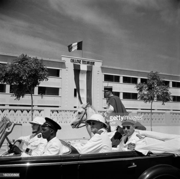 A picture released in 1951 shows European officials riding in front of the technical college of Bamako / AFP /