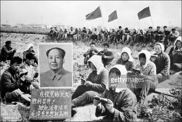 Picture released in 1969 by Chinese official news agency with the caption saying Chinese peasants gather in May 1969 in a field in Hungching region...