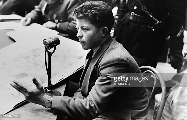 Picture released in February 2 1953 of Roger Godfrin the only child survivor of the massacre and then aged of 8 testifying at the trial of the Nazis...