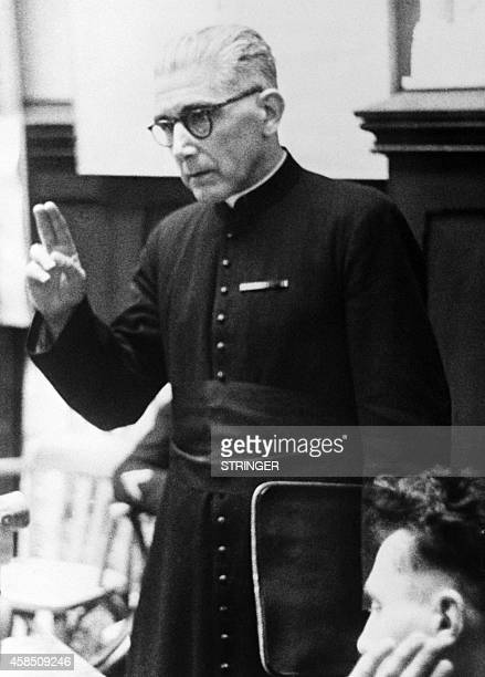 Picture released in February 4 1953 of Leon Neppel general curate of the diocese of Strasbourg testifying at the trial of the Nazis as members of the...