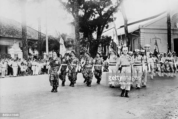 Picture released on April 14 1956 of paratroopers infantrymen and sailors of French army troops marching during a military ceremony towards the War...