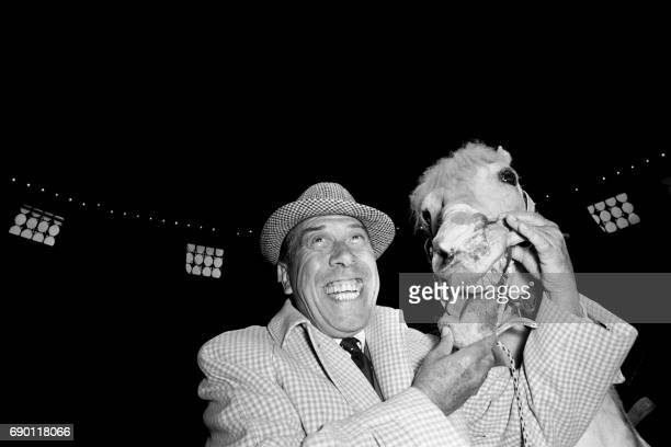 Picture released on April 14 1970 of French actor Fernandel performing during a rehearsal of the French artists Union Gala event at the Cirque...