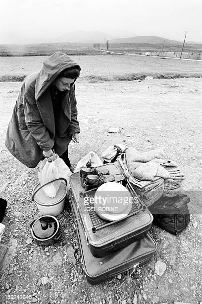 Picture released on April 15 1999 of a refugee from Kosovo under makeshift shelter in the refugee camp in Kukes border of Albania More than 300...