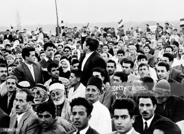 Picture released on April 29 1959 of Kurdish refugees who fled Iraq to take refuge in Syria demontrating in favour of Egyptian president Nasser's...