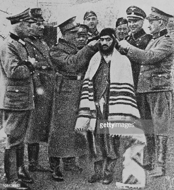 Picture released on April 7, 1961 taken during World War II in the Bergen-Belsen concentration camp shows Nazi leader and war criminal Adolf Eichmann...