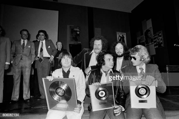 Picture released on August 30 1973 of singers Serge Lama Michel Sardou and Johnny Hallyday and Mort Shuman and Alan Stivell awarded by CEO of...
