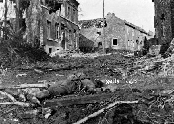 Picture released on December 1 1944 of the dead body of a German young man lying in the wrecked buildings in the streets of devasted town of Frenz in...