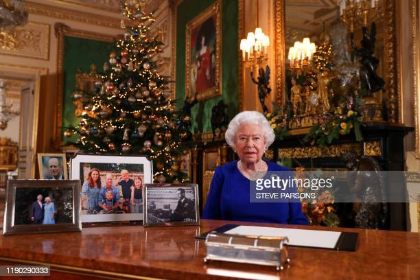 TOPSHOT A picture released on December 24 2019 shows Britain's Queen Elizabeth II posing for a photograph after she recorded her annual Christmas Day...