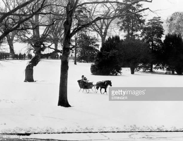 Picture released on February 14 1962 of US president John Fitzgerald Kennedy 's wife Jacqueline Kennedy enjoying a sleigh ride with her children John...