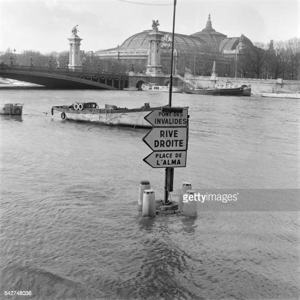Picture released on February 27 1958 near the bridge Alexandre III and the Grand Palais of floods due the thaw in the Paris basin