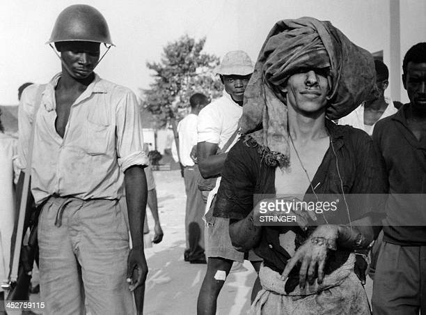 Picture released on January 18 1964 of an Arab prisonner being questioned and jailed in camps during the Zanzibar Revolution by local African...