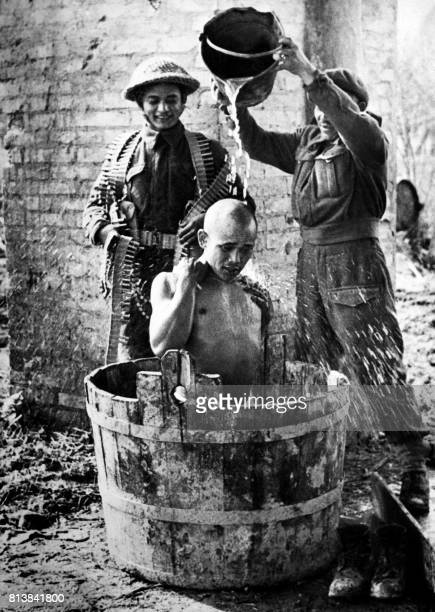 Picture released on March 17 1945 of Gurkhas machinegunners having a bath in the Pacific area during the Second World War The Gorkhas military units...