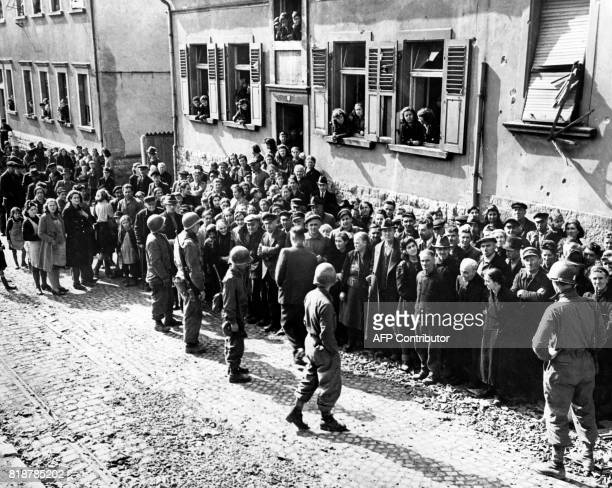 Picture released on March 1945 of US soldiers of the 63d Infantry Division Seventh United States Army rounding up German civilian residents of...