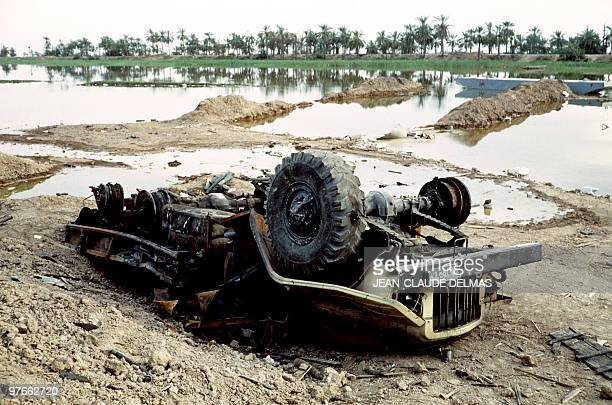 Picture released on March 20 1985 of a destroyed military vehicule in the swamp near the Iraqi city of alHoweizah north of Basra after a fierce...