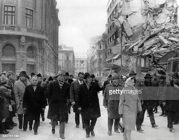 Picture released on March 5 1977 of Romanian president Nicolae Ceausescu observing the damages on the Gheorghe Magheru Boulevard in Bucharest after...