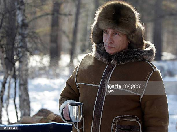 A picture released on March 6 2010 shows Russian Prime Minister Vladimir Putin drinking tea in the Karatash area near the town of Abakan during his...