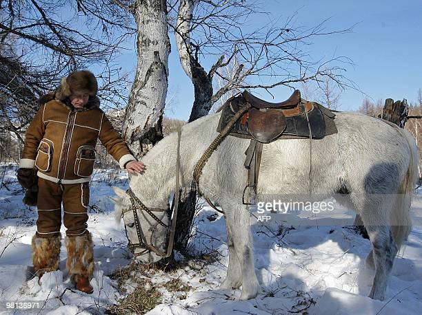 Picture released on March 6, 2010 shows Russian Prime Minister Vladimir Putin taking a horseback ride in the Karatash area, near the town of Abakan,...