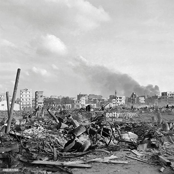 Picture released on November 1956 of ruins and destroyed weapons in Port Said Egypt during the Suez crisis / AFP / STR Photo credit should read STR...