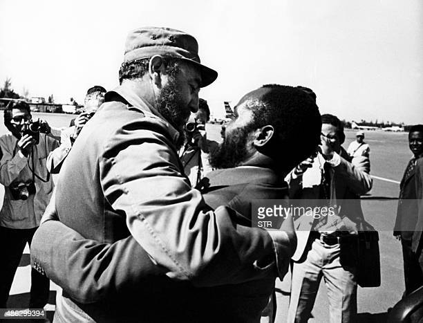 Picture released on November 1977 of president of Mozambique Samora Machel welcomed by President of Cuba Fidel Castro at his arrival at Havana...