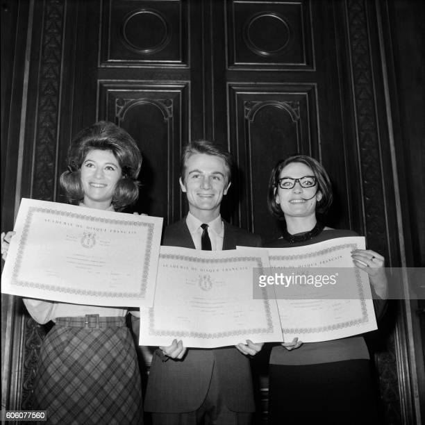 Picture released on November 22 1963 of French singers Sheila Claude François and Greek singer Nana Mouskouri holding their awards of the Academy of...