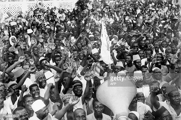 Picture released on November 28 1968 of in the streets of Bamako of Malians celebrating after lieutenant Moussa Traore overthrow president Mobido...