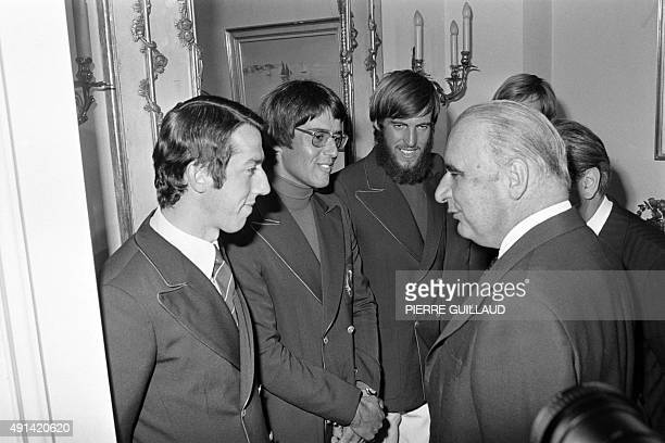 Picture released on September 1 1972 of French president Georges Pompidou greeting French sailors and Olympic champions Yves Pajot and Marc Pajot...