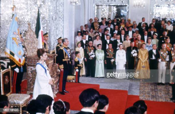 Picture shot 26 October 1967 during the coronation ceremony of Mohammed Reza Pahlavi as Shah of Iran At left stands his wife princess Farah Diba