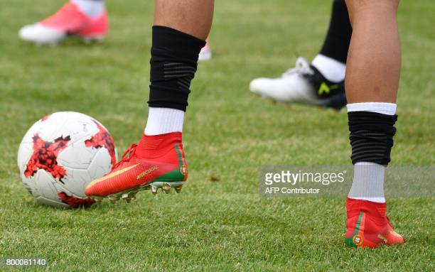 A picture show the feet of Portugal's forward Cristiano Ronaldo during a training session in Saint Petersburg on June 23 2017 on the eve of the 2017...