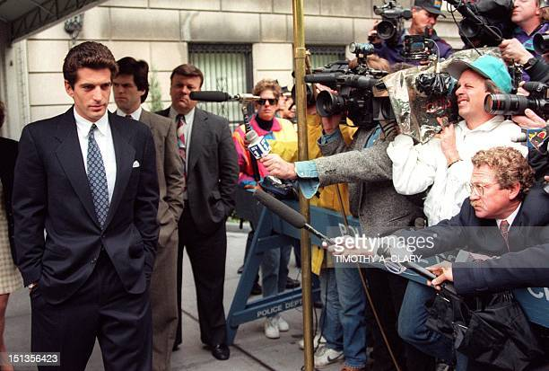 picture showing John F Kennedy Jr answering journalists questions 20 May 1994 soon after his mother Jackie Kennedy's death in New York The plane...