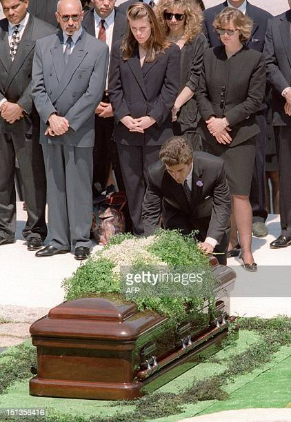 picture showing John F Kennedy Jr during the funeral of his mother Jackie Kennedy 23 May 1994 at Arlington National cemetary The plane piloted by...