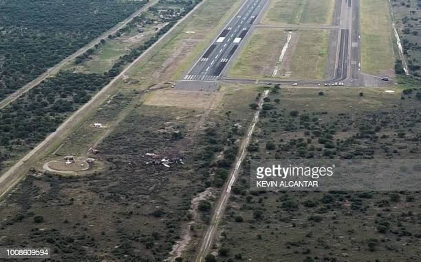 TOPSHOT Picture showing the wreckage of a plane that crashed with 97 passengers and four crew on board on take off at the airport of Durango in...