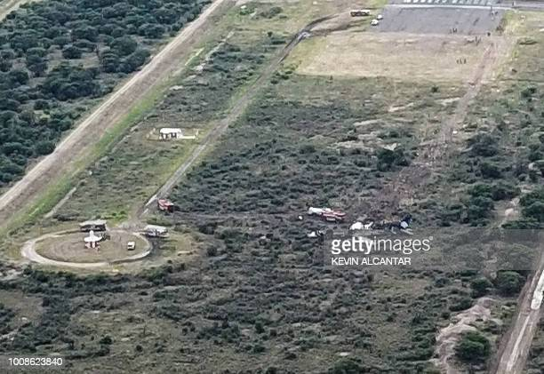 Picture showing the wreckage of a plane that crashed with 97 passengers and four crew on board on take off at the airport of Durango in northern...