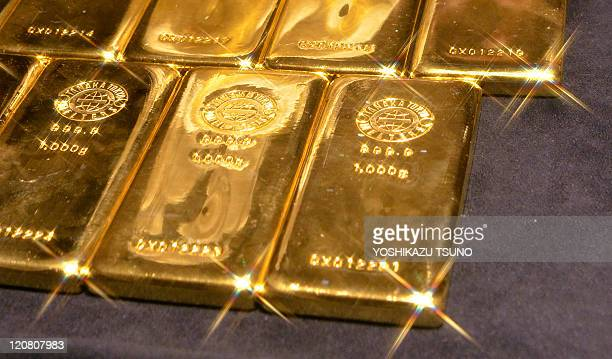 A picture shows 1kilogram gold bars at the main shop of Japanese jeweller Tanaka Kikinzoku in Tokyo on August 11 2011 Gold prices surged past 1800...