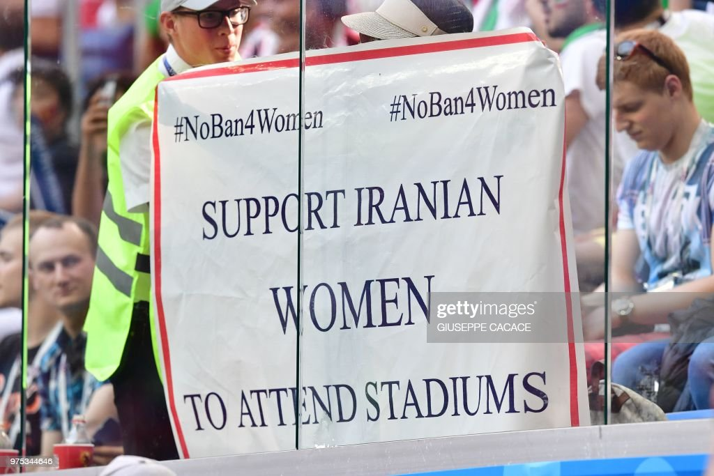 TOPSHOT - A picture shows a banner reading 'Support Iranian women to attends stadiums' during the Russia 2018 World Cup Group B football match between Morocco and Iran at the Saint Petersburg Stadium in Saint Petersburg on June 15, 2018. (Photo by Giuseppe CACACE / AFP) / RESTRICTED